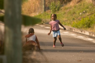 girl playing in the streets of la gaulette mauritius 375x250 Mauritius