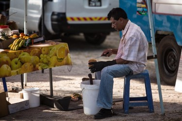 man cutting pineapple at le morne beach mauritius 375x250 Mauritius